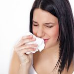 bigstock-Young-woman-sneezing-flu-or-a-30687878